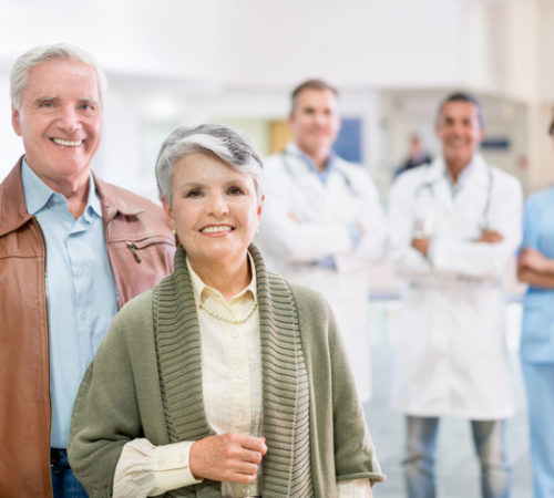 Senior patients at the hospital paying a visit to the doctor - healthcare and medicine concepts